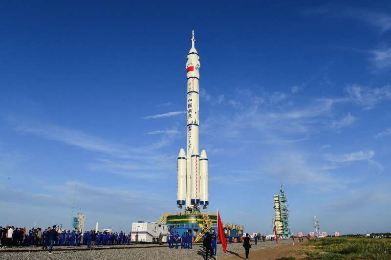 Rocket blasts off carrying first Chinese crew to new space station Tiangongs-first-crew-w