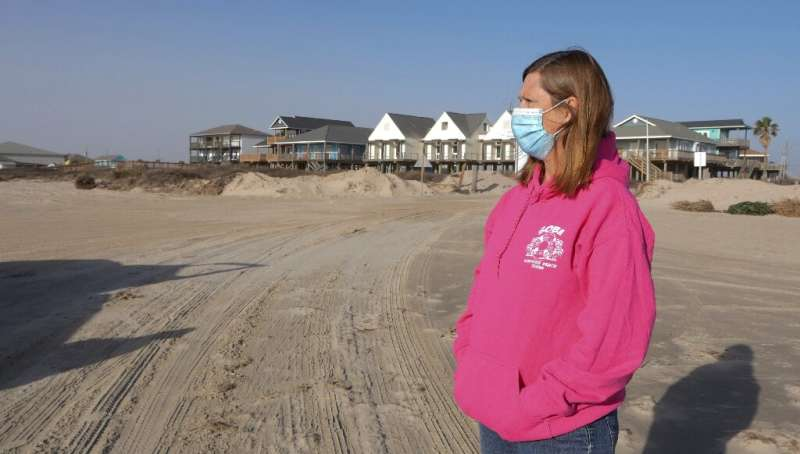 Toni Capretta, president of the Save Our Beach association, looks on during Dunes Day at Surfside Beach, Texas, on January 16, 2