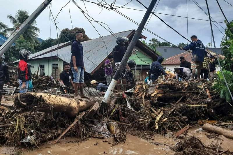 Torrential rains from Tropical Cyclone Seroja turned small communitiesinto wastelands of mud and uprooted trees
