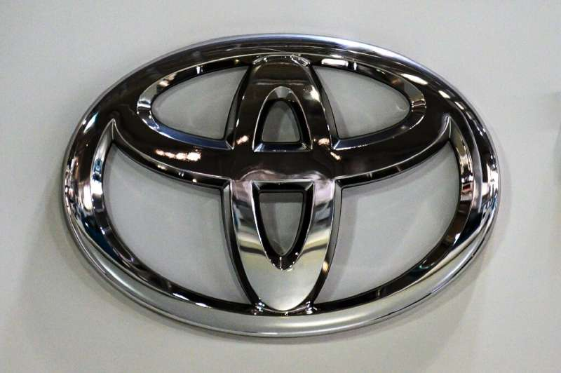 Toyota said net profit soared 50 percent in the third quarter and upgraded its full-year forecasts as the global auto industry g