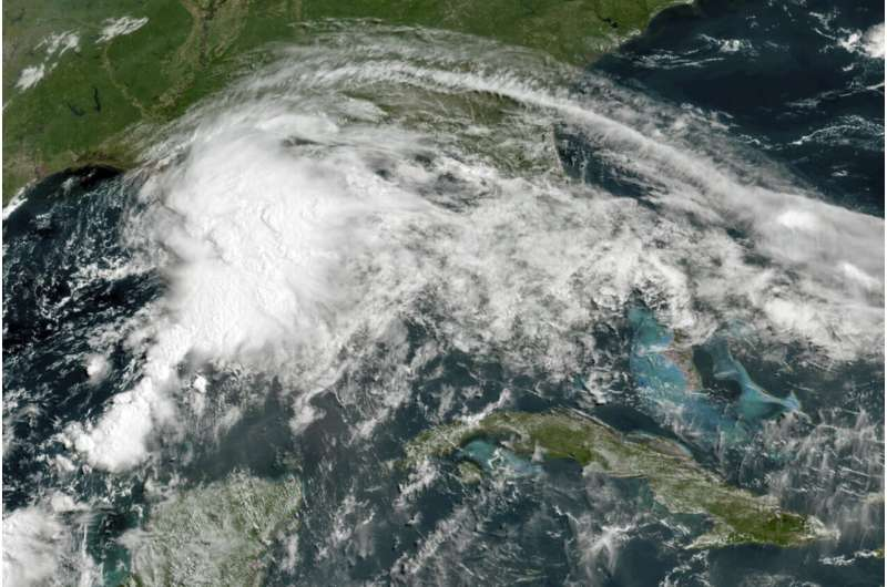 Tropical weather lashes Gulf Coast with brisk winds, rain