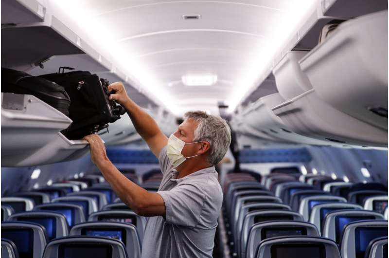 TSA extends into January mask rule for airline passengers