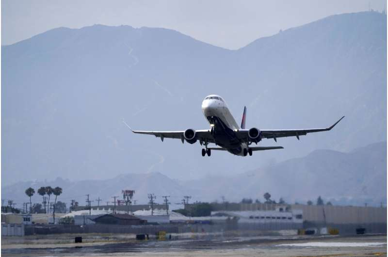 United sees more travel rebound, adds flights to warm spots