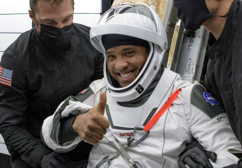 US astronaut Victor Glover after exiting the SpaceX Crew Dragon capsule that brought him back to Earth, landing off Florida May