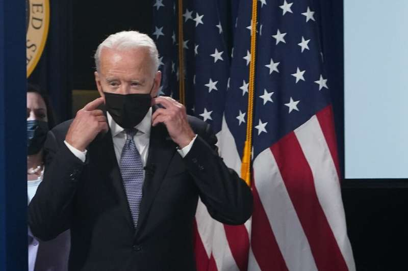 US President Joe Biden said new virus restrictions are possible as cases climb