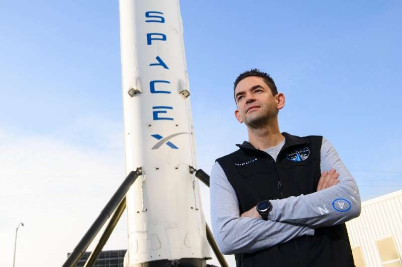 US tech billionaire Jared Isaacman in front of the first stage of SpaceX's Falcon 9 rocket, in February 2021 in Hawthorne, Calif