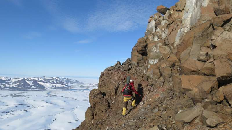 Volcanic surge narrowed seas during ancient global warming event