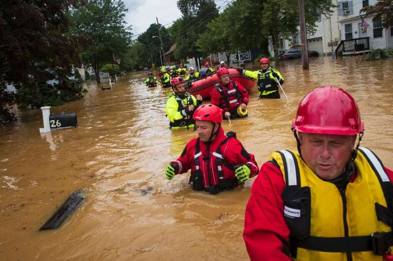Volunteer firefighters perform a secondary search during an evacuation effort in Helmetta, New Jersey on August 22, 2021