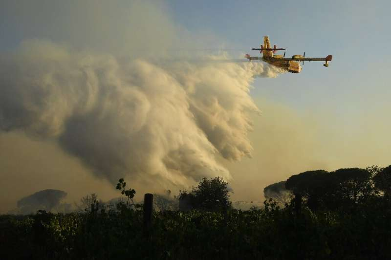 Water-dropping planes and helicopters were used to control the flames