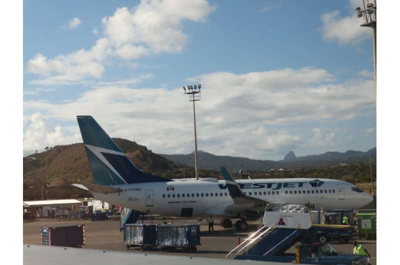 Westjet, Canada's second largest airline, announces temporary layoffs of as many as 1,000 staff as demand for flights dropped of
