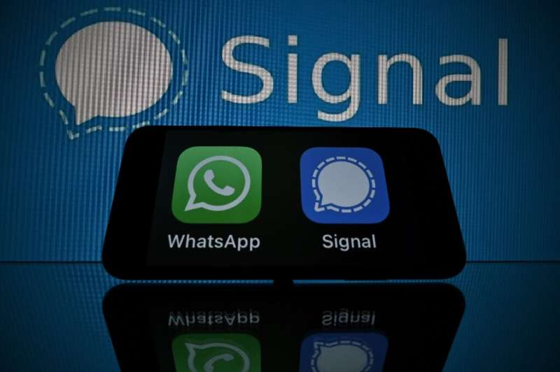 WhatsApp (green logo, left) reassured users about privacy as it faces rival secure mobile messaging services such as Signal