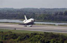 Space shuttle Discovery, crew of 7 back on Earth (AP)