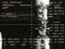 Russian spacecraft docks at orbiting station (AP)