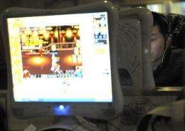 A chinese man plays on the computer