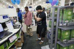 A man shops for a laptop at a Best Buy store in Florida