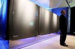 "A man stands next to a Bloom Energy server called a ""Bloom Box"""