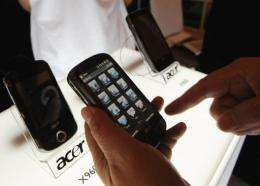 A member of the media browses through the Acer M900 smartphone