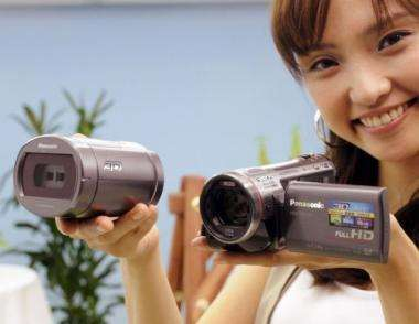 A model from Panasonic unveils the world's largest 3D camcorder