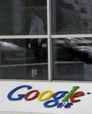 An employee walks in the lobby of the Google China headquarters