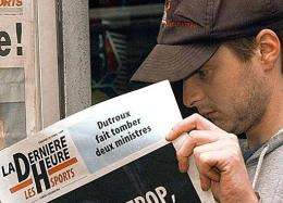 "An inhabitant of Neufchateau, Belgium reads ""La Derniere Heure"""