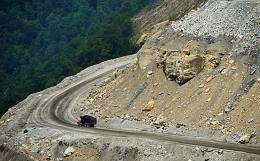 A truck makes its way from a coal mine
