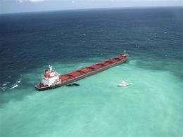 Australia questions crew of ship that ran aground (AP)