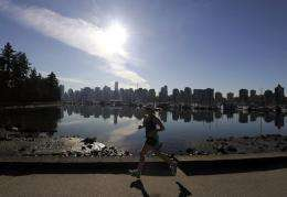 A woman joggs in Stanley Park