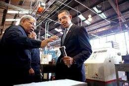 Computerized numerical lathe operator Don Marks (L) speaks with President Barack Obama