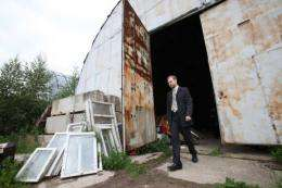 Danila Medvedev leaves a warehouse that contains some of the company's low-temperature human storage units