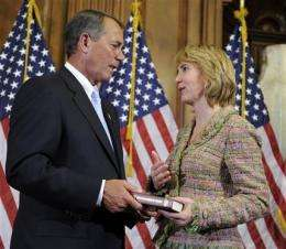 Doctors replace Giffords' breathing tube (AP)