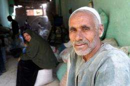 Egyptian farmer Mohammed Abdel Ghani waits for his rice to be processed at a mill in al-Ramlah village