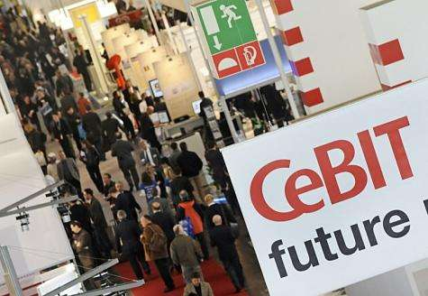 Fair visitors crowd the halls of the world's biggest high-tech fair, the CeBIT in Hanover, in 2010