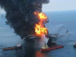 Fire boat response crews as they battle the blazing remnants of the off shore oil rig Deepwater Horizon