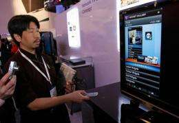 Hideo Kataoka gives a demonstration of Toshiba's widget-enabled televisions