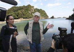 Japan dolphin hunt town meets with activists (AP)