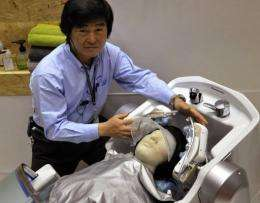 Japan electronics giant Panasonic unveils the robot hair-washer