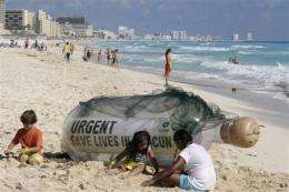 Man, climate combine to erode Cancun's beaches (AP)
