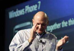 Microsoft earnings rise with business spending (AP)