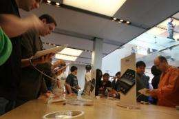 People at the SoHo New York Apple store try out the iPad