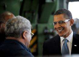 President Barack Obama chats with workers