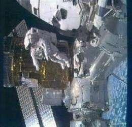 Robotics shutdown briefly strands astronaut (AP)