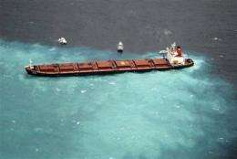 Salvaging ship from Barrier Reef could take weeks (AP)