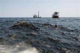 Sandbags to try to block oil blobs in Louisiana (AP)