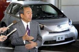 "Takeshi Uchiyamada, executive vice president of Japanese automaker Toyota Motor, introduces the company's small car ""iQ"""