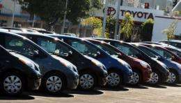 Toyota cars are lined up for sale at a Toyota dealership