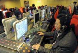 Web surfers at an internet cafe in Beijing
