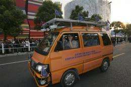 Without driver or map, vans go from Italy to China (AP)